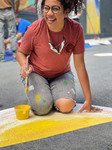 Sury Chavez expands her mural on the walls of Division on to the roadway