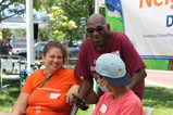 Volunteer Bruce Williams shares a laugh with Jessica Mortell of Neighborways.