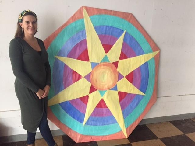 Jenna Kilman poses with her giant kite