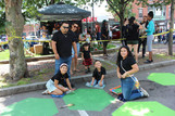A family during the Community Painting Day 2021  in Chelsea Square