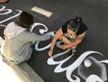 The Sirens working on their road mural for Division Street