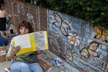 Marianne Ramos shows her mural's sketch in process