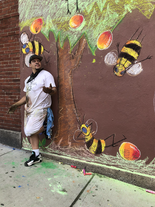 Artist Max Pro with this mural