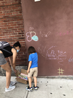 Community joins in the chalk art