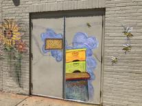 Marianne Ramos mural on side of ROCA