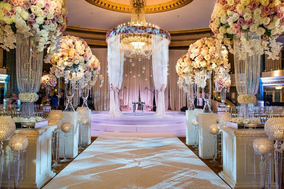 Opulent blooms and a circular altar create a moment of magic at any wedding.