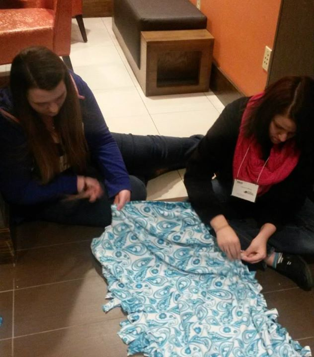 Making blankets to donate to the Humane Society
