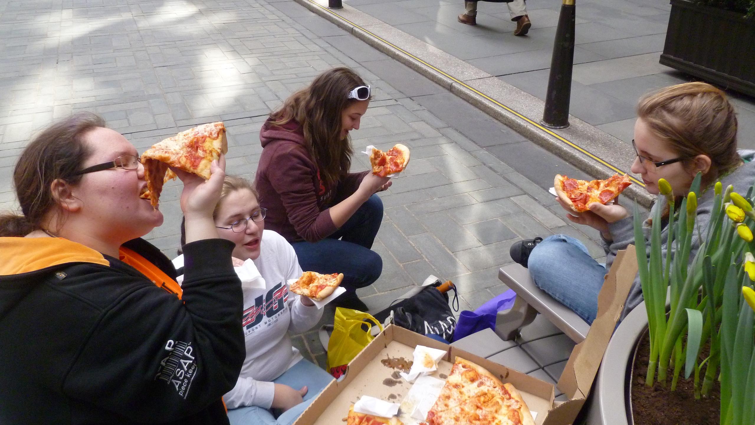 Sitting in Rockefeller Plaza eating New York pizza for lunch!