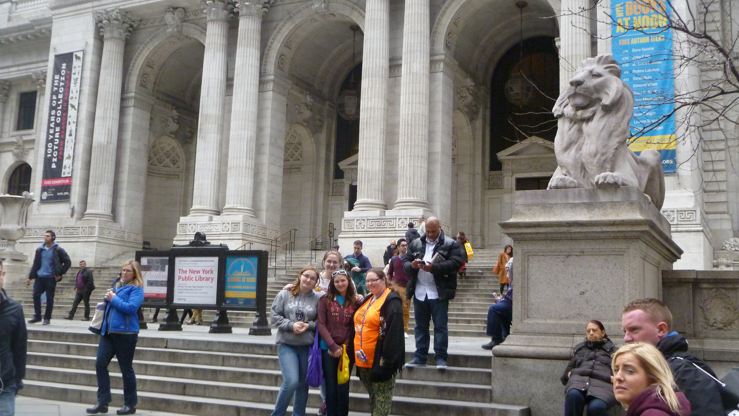 A few students on the steps of the famous New York Public Library