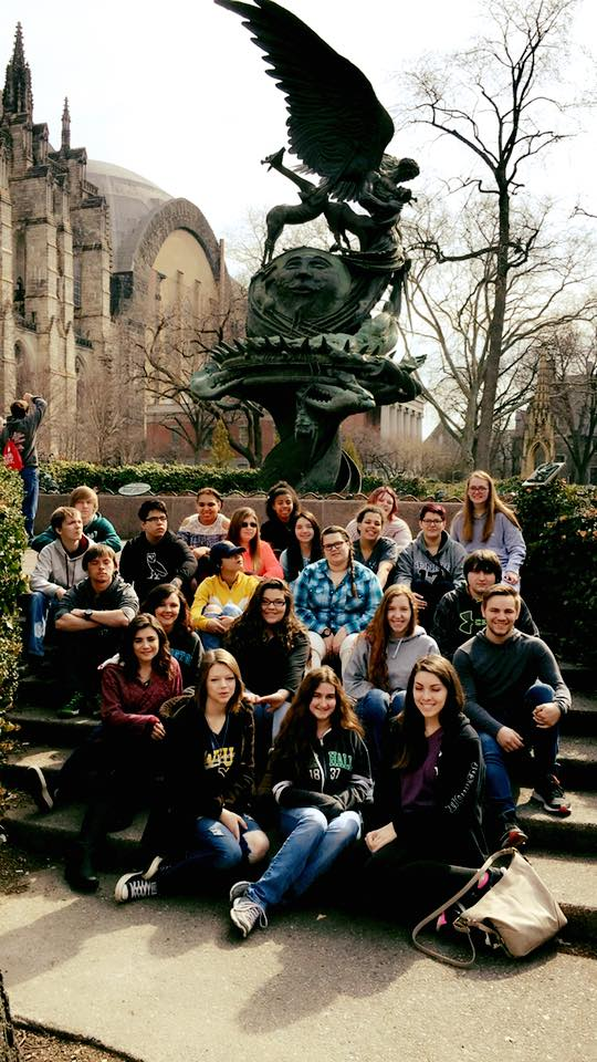 Group photo in front of the statue at the Cathedral of St. John the Divine