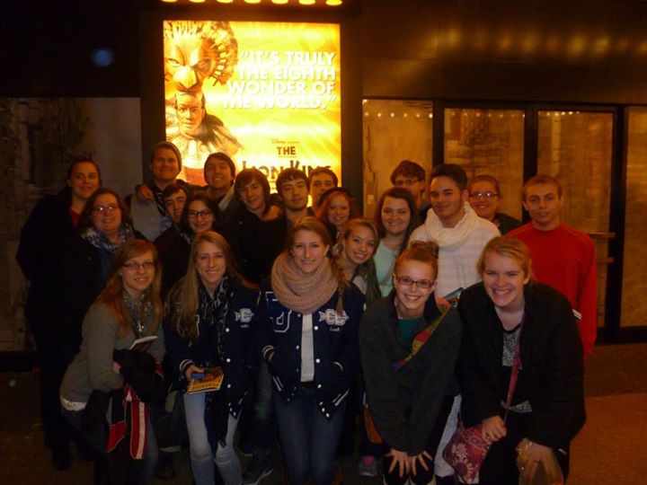 Posing by the marquee after watching The Lion King on Broadway