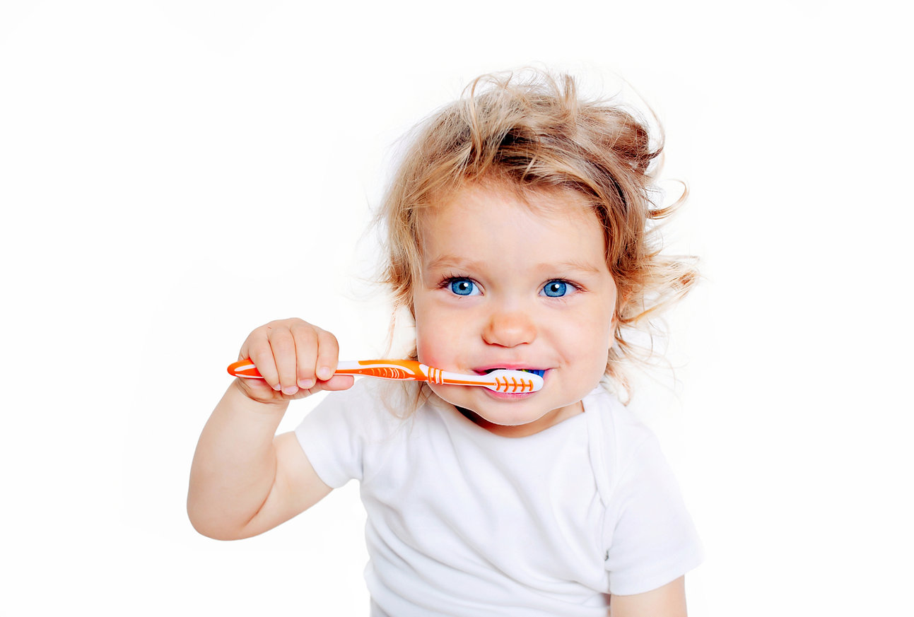 Curly baby toddler brushing teeth. Isola