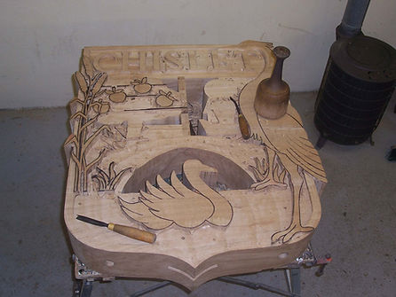 The rear of the Chislet sign part way through carving