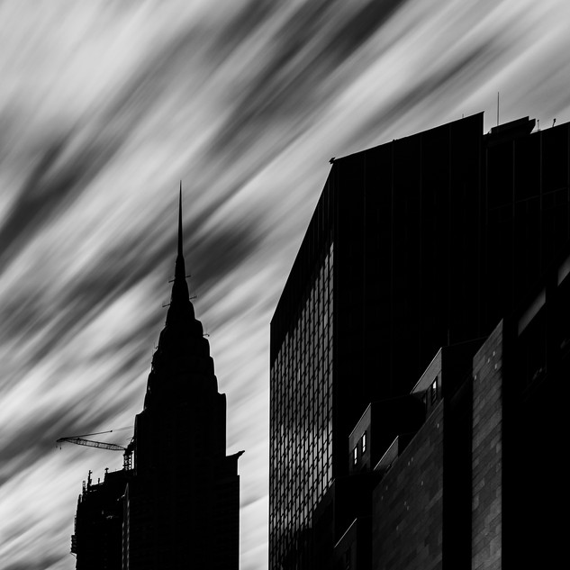 Chrysler Building Amidst Rapidly Moving