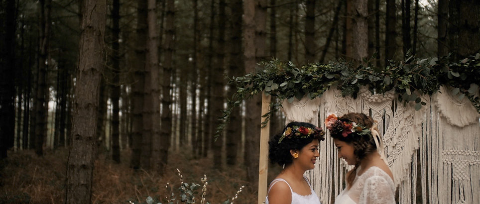 same sex wedding forest boho looking at each other wedding film