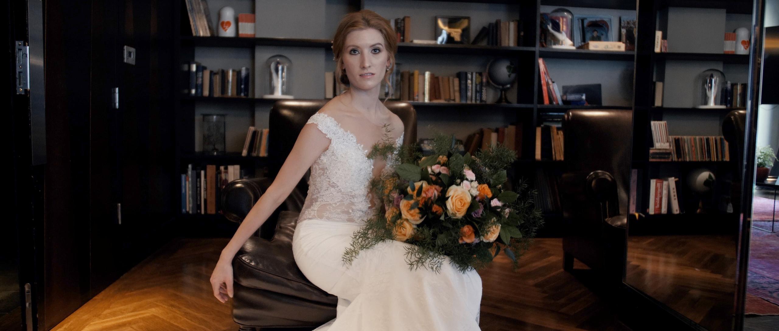 Bride sitting with flowers aloha london wedding films videographer