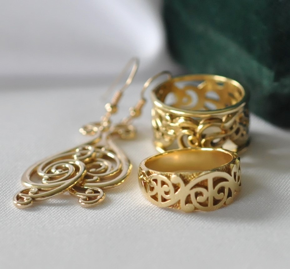 Koru designs in Gold