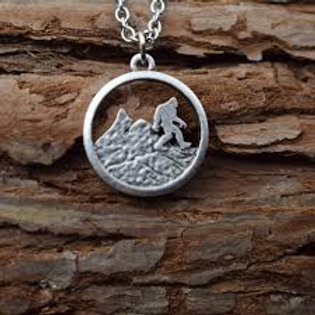 Silver plated Bigfoot necklace running in the mountain