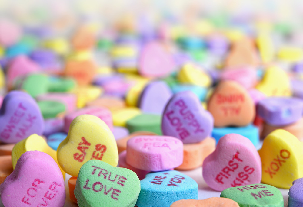 Colorful heart candies with various messages written on them