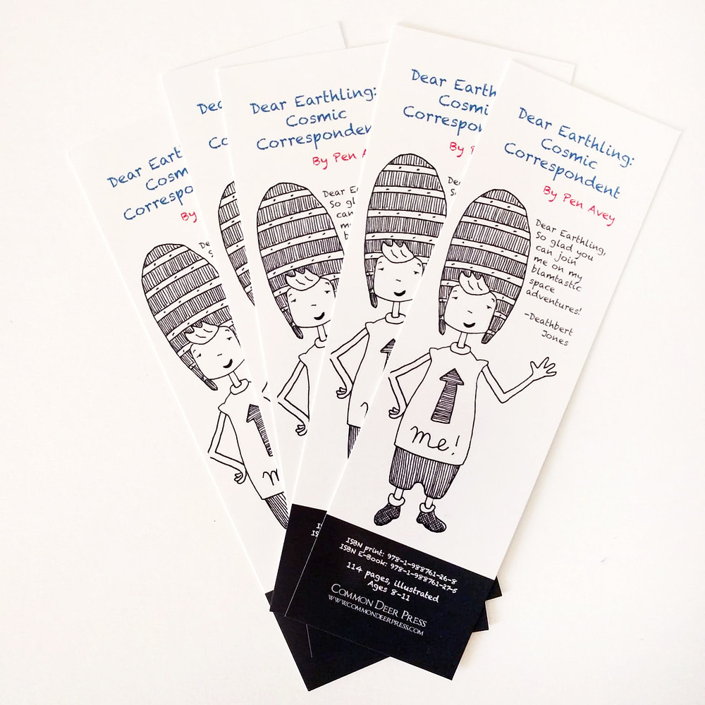 Five Cosmic Correspondent bookmarks fanned out against a white surface