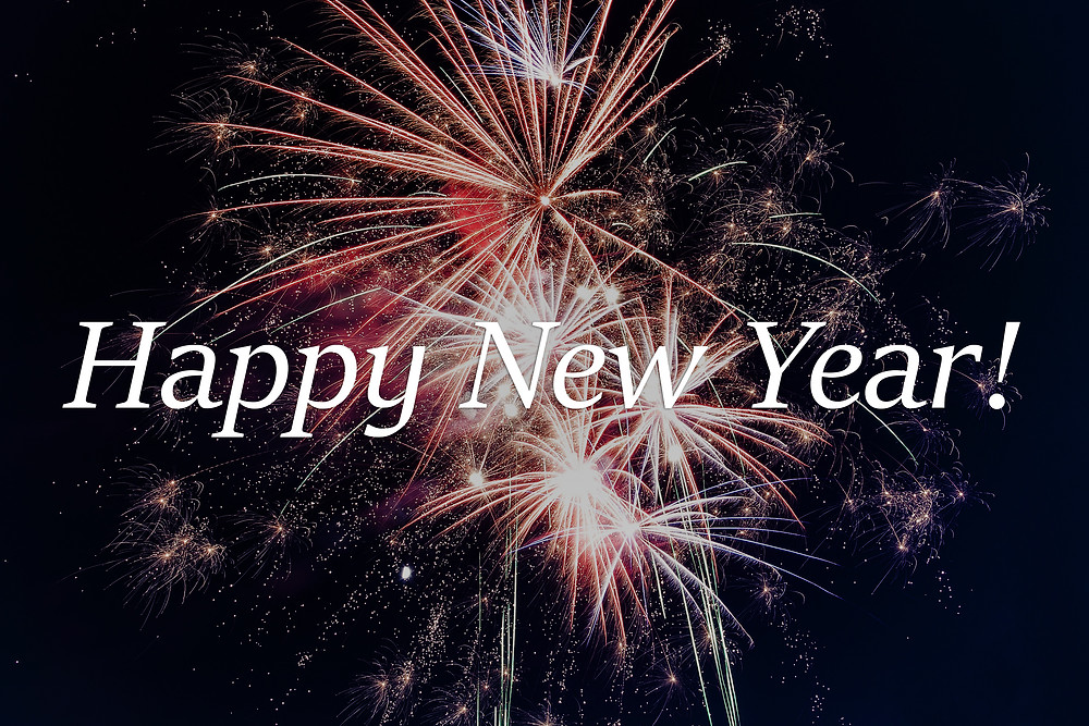Happy New Year in white text on a background with fireworks