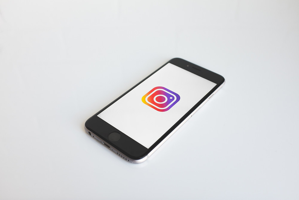An iPhone with an Instagram logo displayed