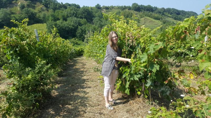 Katarina standing in a vineyard