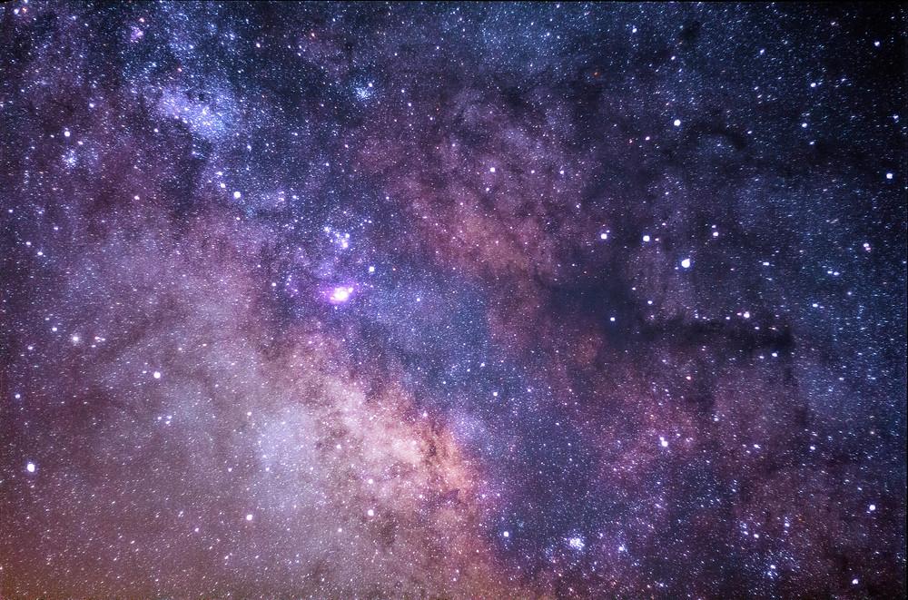 A starry, purple nebula