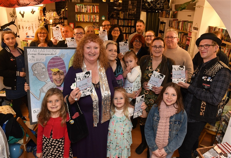 Launch of Tilney All Saints Author Pen Avey's children's book at No 8 Old Bookshop in Downham. ..Pen Avery (front centre) at the launch with her books, guests, family and friends.. (5729543)