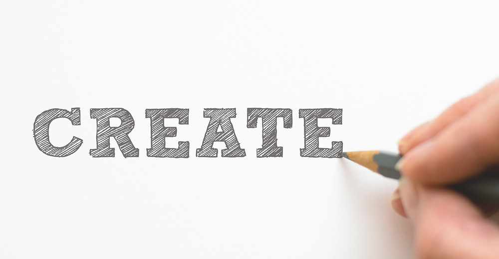 "Hand writing ""create"" in block letters"