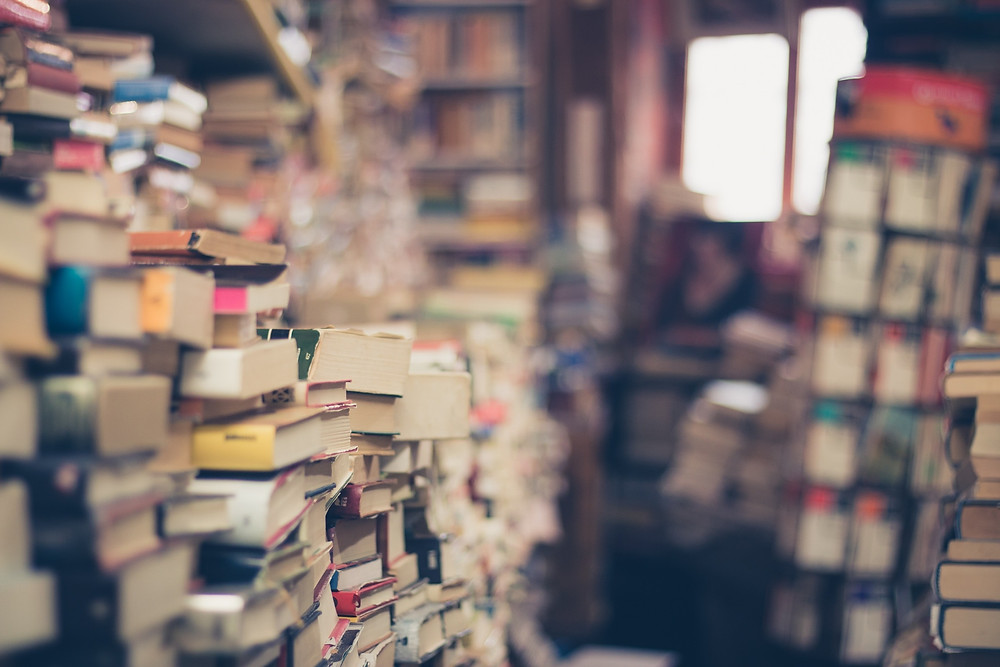 Stacks of books in a bookstore