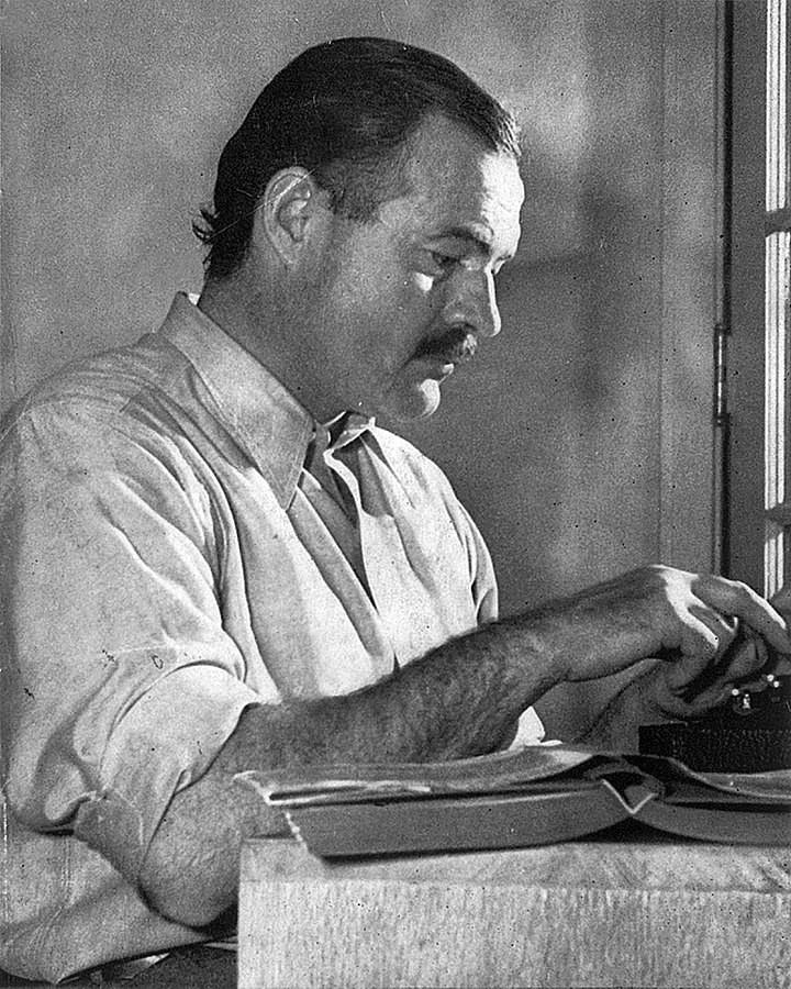 Ernest Hemingway at a typewriter