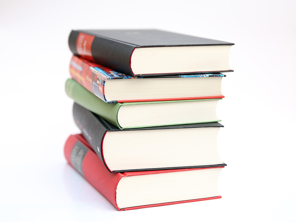 A stack of books against a white background