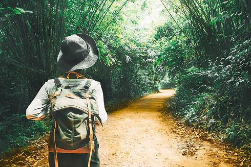 Traveler woman with backpack walk alone