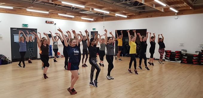 A group of people in a dance fitness class at the SportsPark gym, Reading.