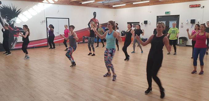 A group of ladies in a dance fitness class at the SportsPark gym, Reading.