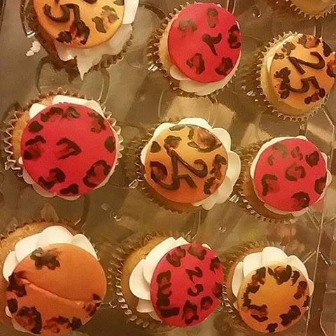 Hand painted leopard print Mimosa cupcakes