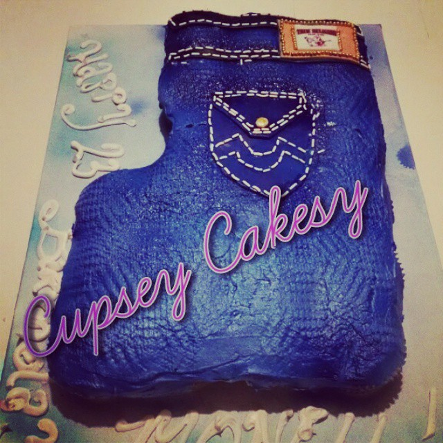 Folded pair of jeans!! Cupcake cake.