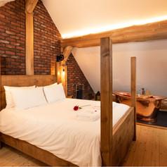 Log Cabin Bedroom brick effect copper ba