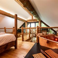 Log Cabin open plan bedroom.jpg