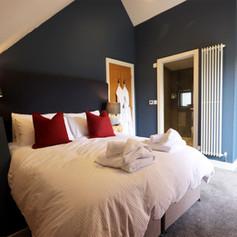Log Home Bedroom blue.jpg