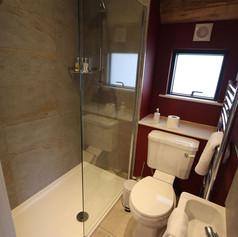 Log Cabin tiled bathroom.jpg