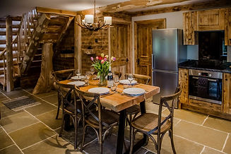 Log cabin staircase and kitchen.jpeg
