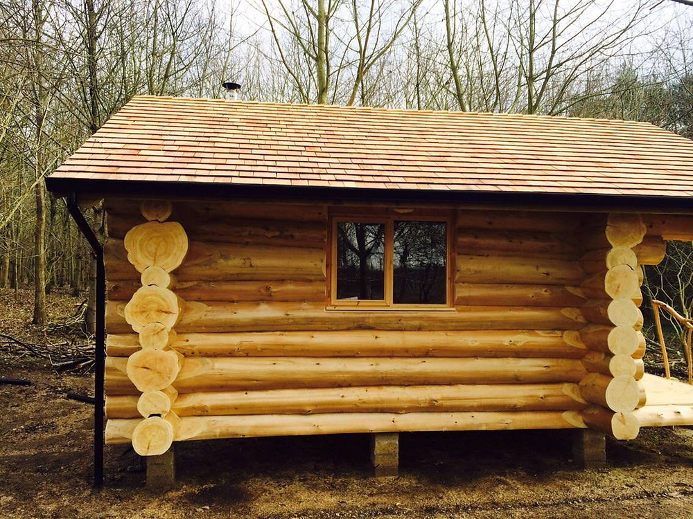 The outside of a small hand-built British Log Cabins cabin