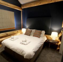 Log Cabin Bedroom Blue.jpg