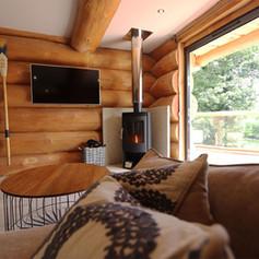 Log burner in a log cabin cosy.jpg