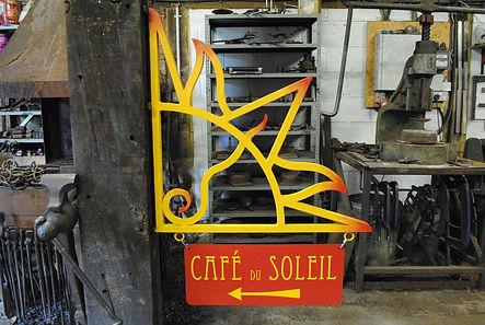Cafe du Soleil sign by Joel Tarr artist blacksmith