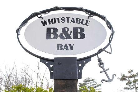 Whitstable Bay sign by Joel Tarr artist blacksmith