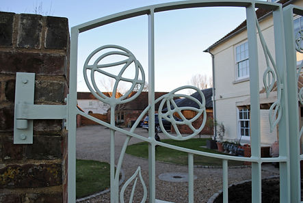 Stained glass gates by Joel Tarr artist blacksmith