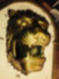 Ismaskin föreställande ett guldfärgat lejon